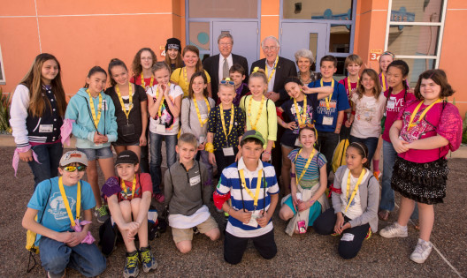 Dr Tjellström together with Cochlear's Graheme Clark, and a small percentage of all the children they've helped overcome their hearing loss, at the Cochlear Celebration in San Diego 2013