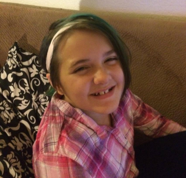 Shalynn, an 11-year-old girl, smiles while wearing the Baha Softband