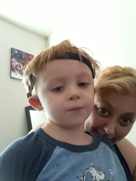 Jen poses with 3-year-old Xander, wearing his Baha 5 Sound Processor on a Softband.